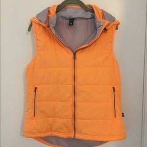 Lightweight puffy orange and gray vest.